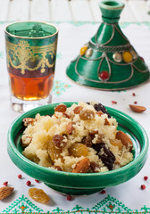 Wall Mural - Moroccan couscous with dried fruit and nuts in tajíne