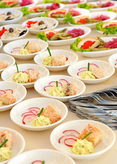 Assorted individual salads on a buffet