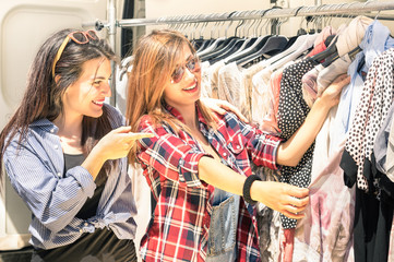 Young beautiful girlfriends at the weekly cloth market