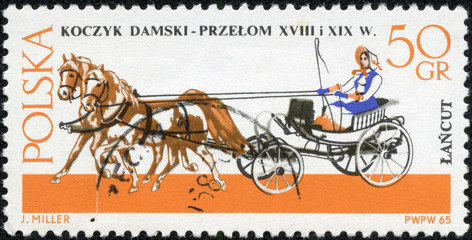 stamp printed in Poland shows old chariot - chaise