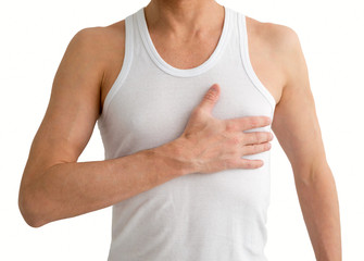 Man in white undershirt with hand on his heart