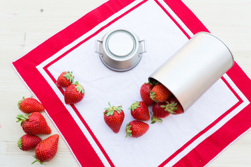 strawberry fruits with case on red tablecloth