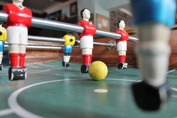 Foosball football tabletop in team colors soccer stock photo, stock photograph, image, picture,