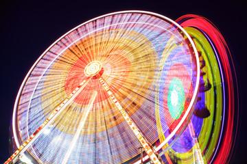 Amusement park at dusk - Ferris wheel in motion