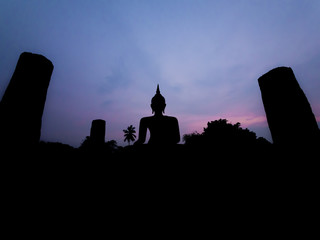 Silhouette buddha image at twilight at Wat Mahathat Sukhothai Th