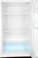 Open empty white refrigerator