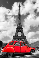 Eiffel Tower with red old car in Paris, France