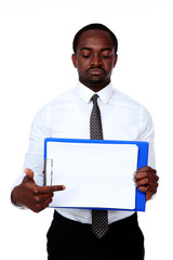 African man holding folder and showing on blank document