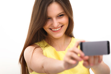 Beautiful girl taken taking selfie self-portrait with phone