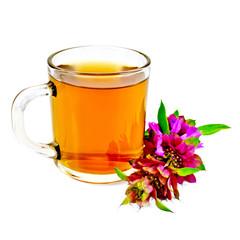 Herbal tea with bergamot in glass mug