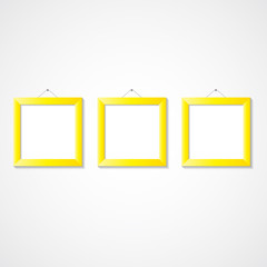 Three golden picture frames