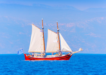 Old wooden red Greek boat (Perama) in Spetses island in Greece