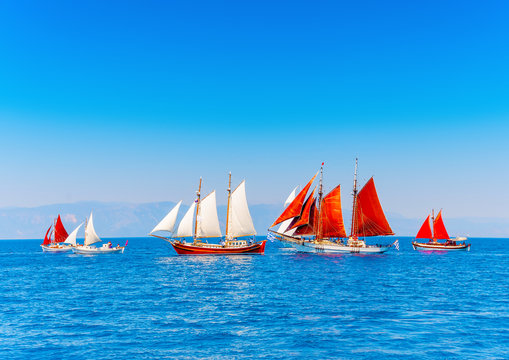 several old wooden sailing boats in Spetses island in Greece