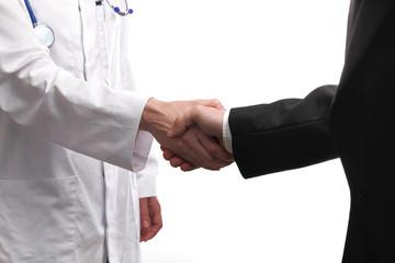 handshake between a doctor and a patient