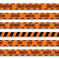 Set of orange warning tapes