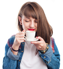 young girl smelling a delicious coffee on white background