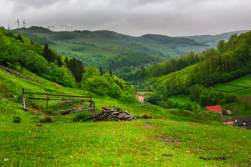 fence in mountains  on hillside  near village