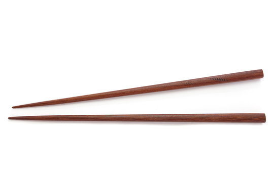 brown wooden chopsticks isolated on white