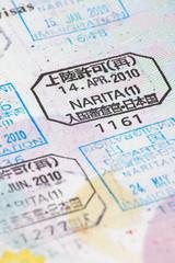 Close - up many international passport stamps