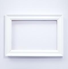 White wooden photo frame on white background