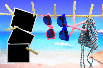 Photo frames and beach items hanging on a rope