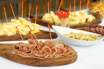 Catering, assorted meats and sausages, olives and spices