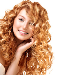 Teenage model girl portrait isolated on white. Red curly hair