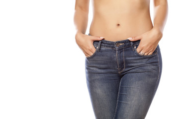 female hips in jeans on white background
