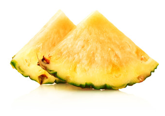 slice of ripe pineapple on a white background