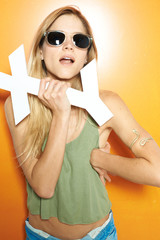 Portrait of a fresh and funny blonde girl with sunglasses