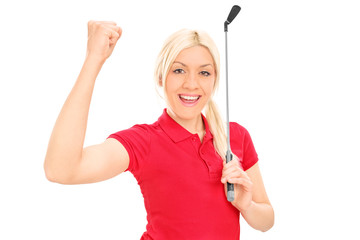 Female golfer celebrating victory