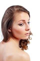 Portrait of a beautiful young woman with evening make-up