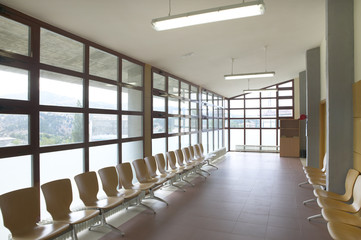 Modern building waiting area with wooden seats