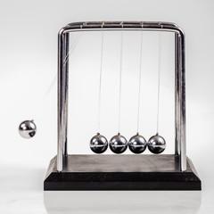 Moving Newton's cradle