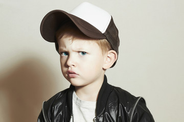little boy.fashion children.Boy in Tracker Hat.Sad Child