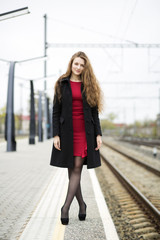 Woman at red dress with crossed legs