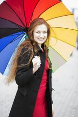 Woman posing at camera with umbrella