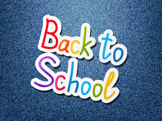 Back to school message on jeans background