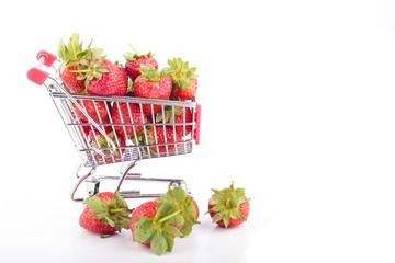 Fresh strawberries in a supermarket cart