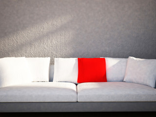the red and the white  pillows are  on the sofa