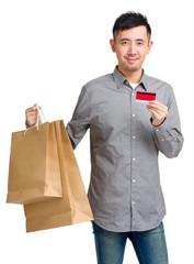 Man hold shopping bag and credit card