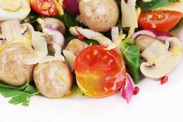 Mushroom salad with tomatoes and quail eggs.
