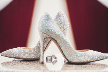 Wedding-ring and woomen shoes acute coe