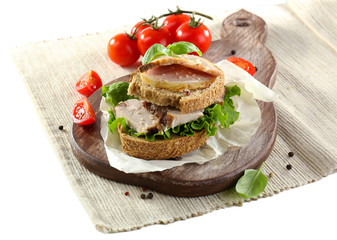 Delicious sandwiches with meet isolated on white