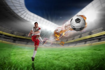 Keuken foto achterwand voetbal Composite image of football player in white kicking