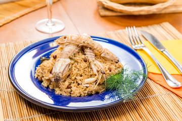 Porzione di risotto con cicale