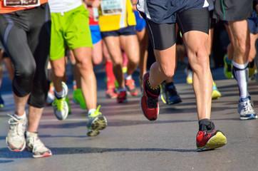Marathon running race, people feet on road Wall mural