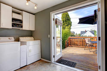 Laundry room with exit to walkout deck