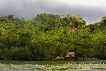 Village on the river before rain storm in Guatemala