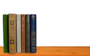 Books on wood shelf
